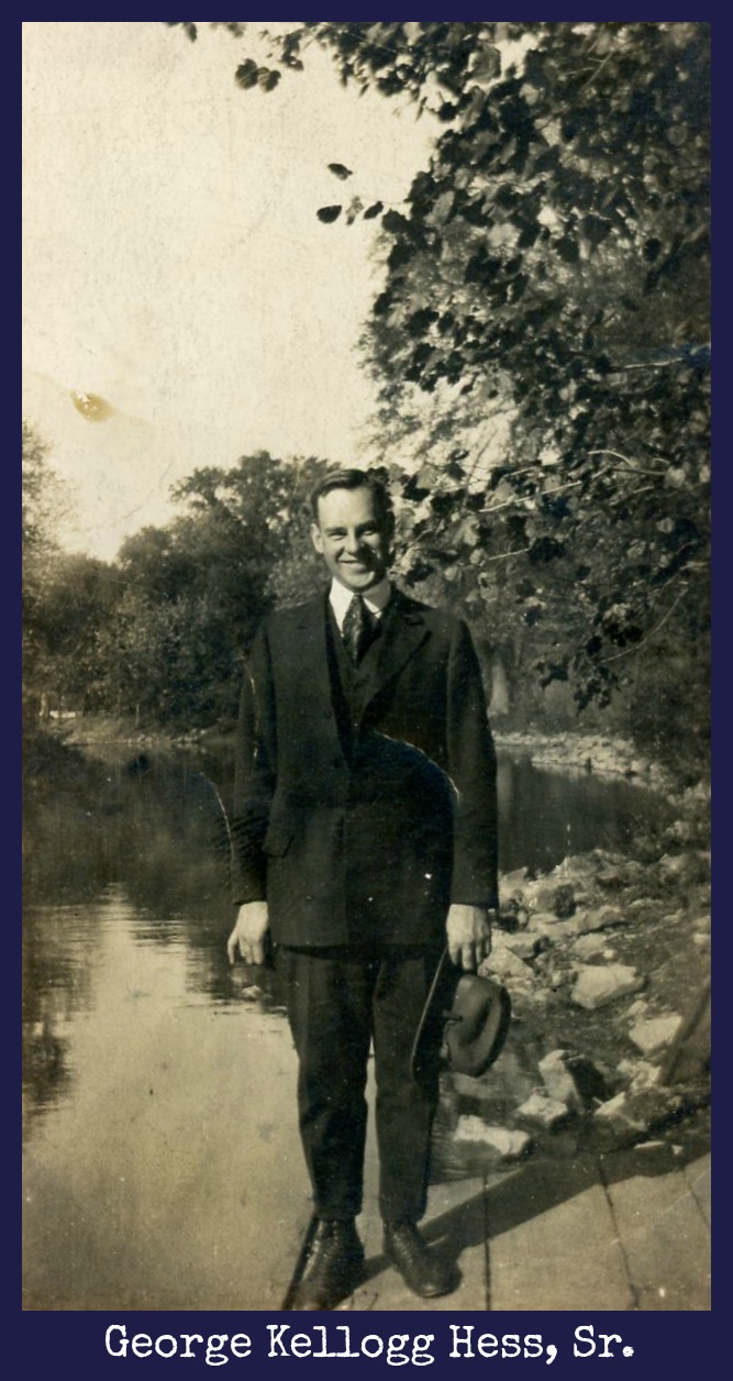 George Kellogg Hess, Sr. holding hat by water's edge