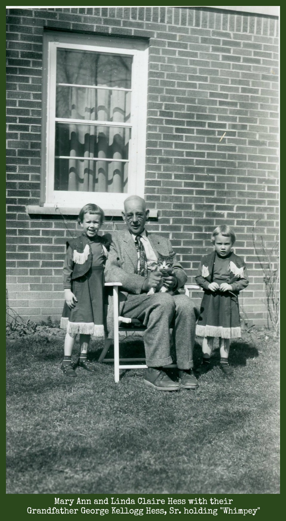 George Kellogg Hess Sr. holding Whimpey with Mary Ann and Linda Claire