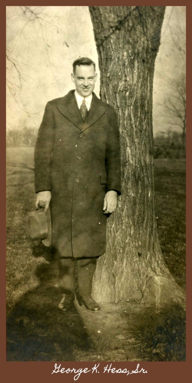 George Kellogg Hess, Sr. next to tree holding hat
