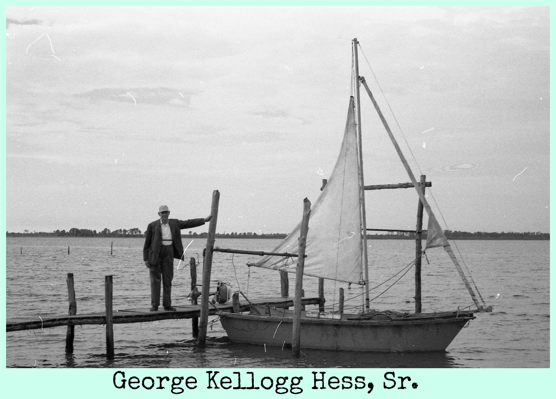 George Kellogg Hess, Sr. on dock by sailboat.jpg