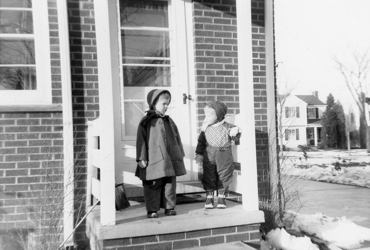 Hess girls in snow suits on the back porch of Harbrooke 1956