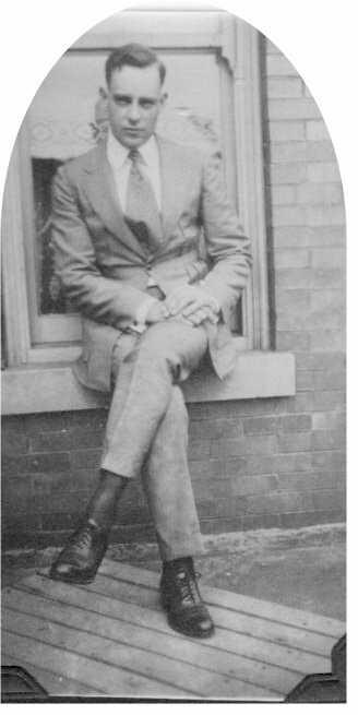 George Kellogg Hess, Sr. on a window sill